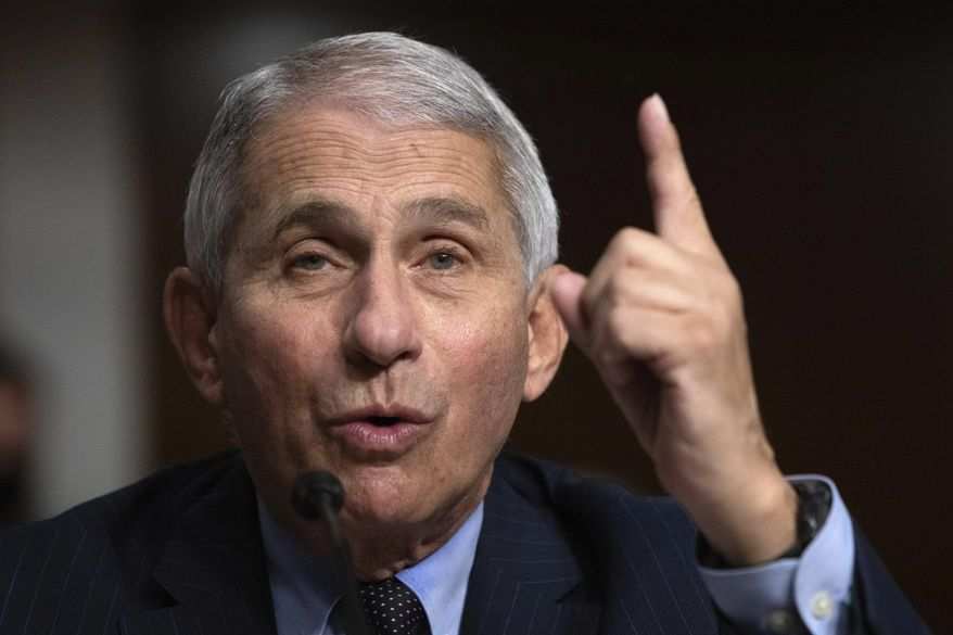 Dr. Anthony Fauci, director of the National Institute of Allergy and Infectious Diseases at the National Institutes of Health, testifies during a Senate Senate Health, Education, Labor, and Pensions Committee Hearing on the federal government response to COVID-19 on Capitol Hill Wednesday, Sept. 23, 2020, in Washington. (Graeme Jennings/Pool via AP) ** FILE **