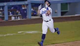 Los Angeles Dodgers' Max Muncy heads for home after hitting a two-run home run during the third inning of the team's baseball game against the Oakland Athletics Tuesday, Sept. 22, 2020, in Los Angeles. (AP Photo/Ashley Landis)