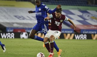 Leicester's Wilfred Ndidi, left, vie for the ball with Burnley's Jay Rodriguez during the English Premier League soccer match between Leicester City and Burnley at the King Power Stadium, Leicester, England, Sunday, Sept. 20, 2020. (AP Photo/Rui Vieira, Pool)