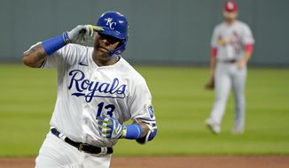Kansas City Royals' Salvador Perez celebrates as he runs the bases after hitting a two-run home run during the first inning of the team's baseball game against the St. Louis Cardinals on Wednesday, Sept. 23, 2020, in Kansas City, Mo. (AP Photo/Charlie Riedel)