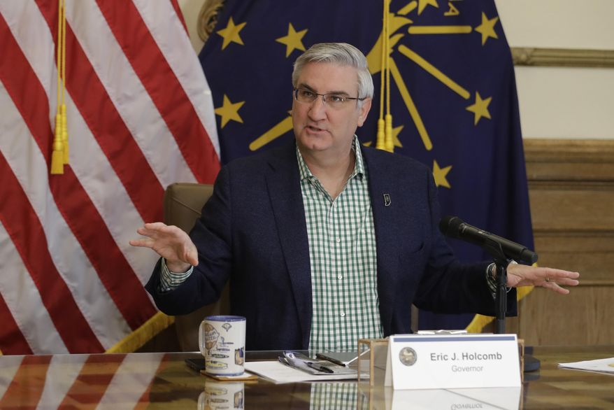 In this April 29, 2020, file photo, Indiana Gov. Eric Holcomb prepares to host a virtual media briefing in the Governor's Office at the Statehouse to provide updates on COVID-19 and its impact on Indiana, in Indianapolis. Gov. Holcomb's statewide mask mandate and six months of other coronavirus restrictions has stirred discontent among conservatives, complicating his front-runner campaign against underfunded Democratic challenger Woody Myers. (AP Photo/Darron Cummings, File)