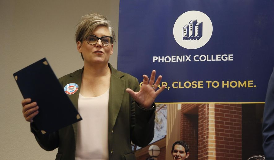 In this Sept. 24, 2019, file photo, Arizona Secretary of State Katie Hobbs talks about voter registration at Phoenix College on National Voter Registration Day in Phoenix. (AP Photo/Ross D. Franklin, File)  **FILE**