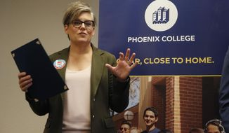 FILE - In this Sept. 24, 2019, file photo, Arizona Secretary of State Katie Hobbs talks about voter registration at Phoenix College on National Voter Registration Day in Phoenix. Arizona Gov. Doug Ducey and Secretary of State Katie Hobbs are sparring over an effort by Hobbs to introduce telephone and videoconferencing options for people to register and vote in certain circumstances. Ducey and some county election officials say the changes Hobbs seeks are illegal. (AP Photo/Ross D. Franklin, File)