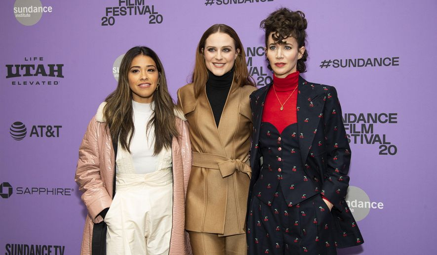 """FILE - Actors, from left, Gina Rodriguez and Evan Rachel Wood pose with writer-director Miranda July at the premiere of """"Kajillionaire""""  during the 2020 Sundance Film Festival in Park City, Utah on Jan. 25, 2020. The film is about a family of grifters in Los Angeles. (Photo by Arthur Mola/Invision/AP, File)"""