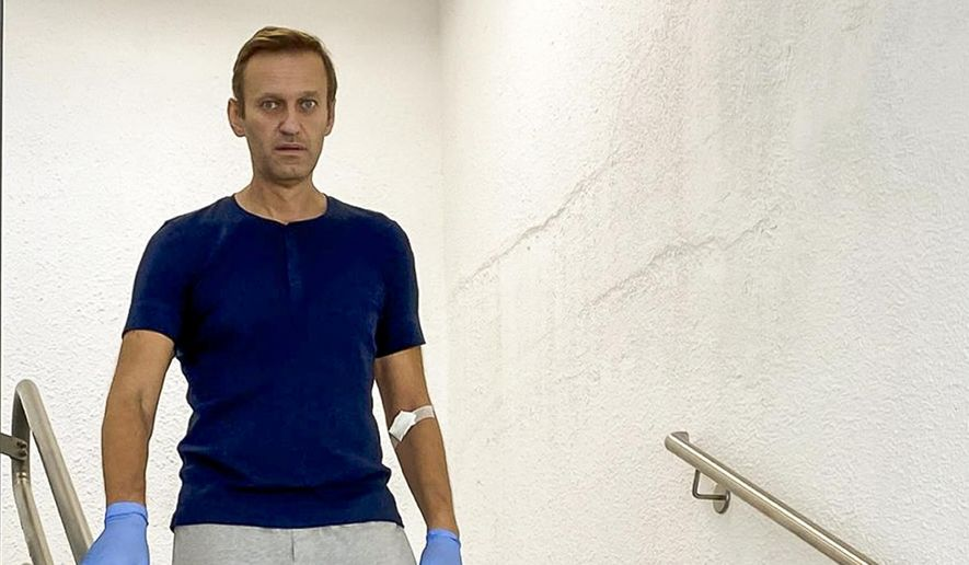 In this photo taken from a video published by Russian opposition leader Alexei Navalny on his Instagram account, Russian opposition leader Alexei Navalny walks down stairs in a hospital in Berlin, Germany, Saturday, Sept. 19, 2020. (Navalny Instagram via AP) ** FILE **