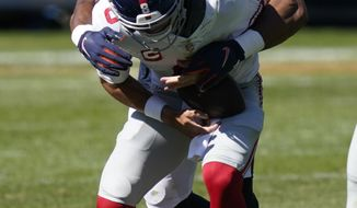 Chicago Bears outside linebacker Khalil Mack (52) sacks New York Giants quarterback Daniel Jones (8) during the second half of an NFL football game in Chicago, Sunday, Sept. 20, 2020. (AP Photo/Charles Rex Arbogast)