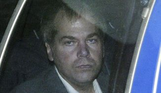 FILE - In this Nov. 18, 2003, file photo, John Hinckley Jr. arrives at U.S. District Court in Washington. Hinckley, who tried to assassinate President Ronald Reagan may soon get the most freedom he's had since since the shooting outside a Washington hotel in 1981. A lawyer for Hinckley Jr. and U.S. attorneys are discussing a possible agreement that would substantially reduce the conditions of Hinckley's release from a mental hospital in 2016, according to federal court hearing on Wednesday, Sept. 23, 2020.  (AP Photo/Evan Vucci, File)