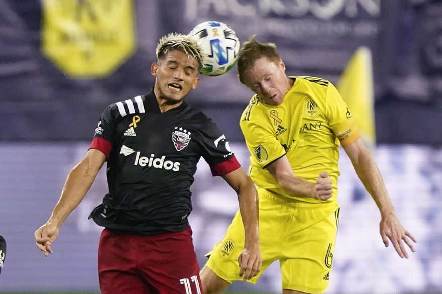 D.C. United midfielder Yamil Asad (11) and Nashville SC midfielder Dax McCarty (6) head the ball during the first half of an MLS soccer match Wednesday, Sept. 23, 2020, in Nashville, Tenn. (AP Photo/Mark Humphrey)  **FILE**