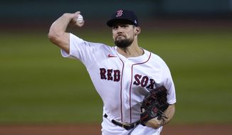 Boston Red Sox starting pitcher Nathan Eovaldi delivers during the first inning of the team'ss baseball game against the Baltimore Orioles in Boston, Wednesday, Sept. 23, 2020, at Fenway Park. (AP Photo/Charles Krupa)