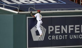 Washington Nationals center fielder Michael A. Taylor climbs the wall in vain on a home run by Philadelphia Phillies' Bryce Harper during the sixth inning of a baseball game Wednesday, Sept. 23, 2020, in Washington. (AP Photo/Nick Wass)
