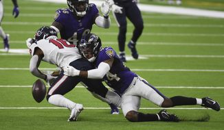 Baltimore Ravens cornerback Marlon Humphrey (44) caused Houston Texans wide receiver Keke Coutee (16) to fumble during the first half of an NFL football game Sunday, Sept. 20, 2020, in Houston. Baltimore recovered and scored a touchdown on the play. (AP Photo/Eric Christian Smith)