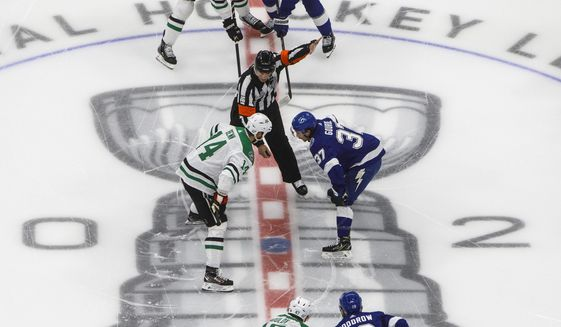 Players from the Dallas Stars and the Tampa Bay Lightning line up for the face off during first-period NHL Stanley Cup finals hockey action in Edmonton, Alberta, Saturday, Sept. 19, 2020. (Jason Franson/The Canadian Press via AP)  **FILE**