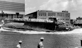 FILE - In this July 9, 1960, file photo, the U.S. Navy nuclear powered attack submarine USS Thresher is launched bow-first at the Portsmouth Navy Yard in Kittery, Maine. The Navy is releasing documents from the investigation into the deadliest submarine disaster in U.S. history. A judge ordered the release of the documents that pertain to the sinking of the USS Thresher 57 years ago, and the first batch was made public on Wednesday, Sept. 23, 2020. (AP Photo, File)