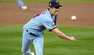 Minnesota Twins pitcher Kenta Maeda throws to a Detroit Tigers batter during the first inning of a baseball game Wednesday, Sept. 23, 2020, in Minneapolis. (AP Photo/Jim Mone)