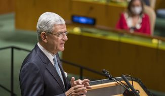 In this photo provided by the United Nations, Volkan Bozkir, president of the seventy-fifth session of the United Nations General Assembly, speaks, Tuesday, Sept. 22, 2020, at U.N. Headquarters in New York. The U.N.'s first virtual meeting of world leaders started Tuesday with pre-recorded speeches from some of the planet's biggest powers, kept at home by the coronavirus pandemic that will likely be a dominant theme at their video gathering this year. (Eskinder Debebe/UN via AP)