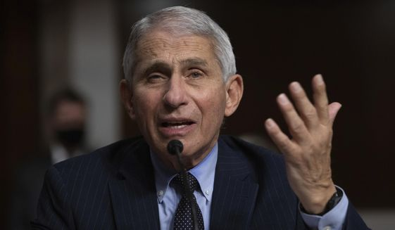 Dr. Anthony Fauci, Director of the National Institute of Allergy and Infectious Diseases at the National Institutes of Health, listens during a Senate Senate Health, Education, Labor, and Pensions Committee Hearing on the federal government response to COVID-19 Capitol Hill on Wednesday, Sept. 23, 2020, in Washington. (Graeme Jennings/Pool via AP)