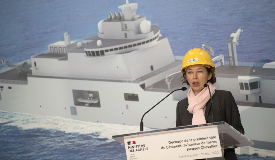FILE - In this May 18, 2020 file photo, French Defense Minister Florence Parly speaks as she attends the first sheet metal cut ceremony of the C35 force refueling vessel, at the Chantiers de l'Atlantique shipyard in Saint-Nazaire, western France. France's Defense Minister Florence Parly admitted to lying about virus protections for air force personnel who evacuated French citizens from Wuhan and have been suspected of links to France's first confirmed COVID-19 cluster. (Loic Venance, pool via AP, File)