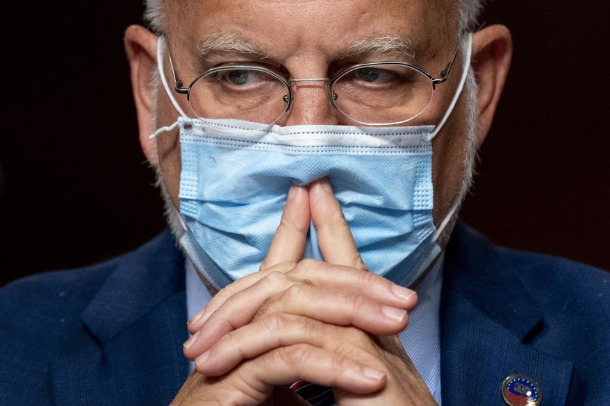 "FILE - In this Sept. 16, 2020, file photo Centers for Disease Control and Prevention Director Dr. Robert Redfield appears at a Senate Appropriations subcommittee hearing on a ""Review of Coronavirus Response Efforts"" on Capitol Hill in Washington. (AP Photo/Andrew Harnik, Pool, File)"
