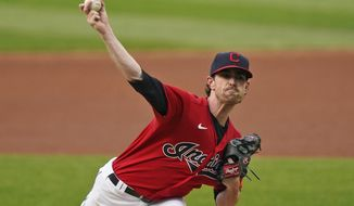 Cleveland Indians starting pitcher Shane Bieber delivers in the first inning of a baseball game against the Chicago White Sox, Wednesday, Sept. 23, 2020, in Cleveland. (AP Photo/Tony Dejak)