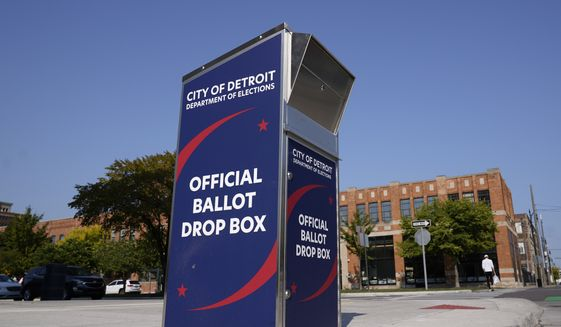 A ballot drop box is shown where voters can drop off absentee ballots instead of using the mail in Detroit Thursday, Sept. 24, 2020. (AP Photo/Paul Sancya)
