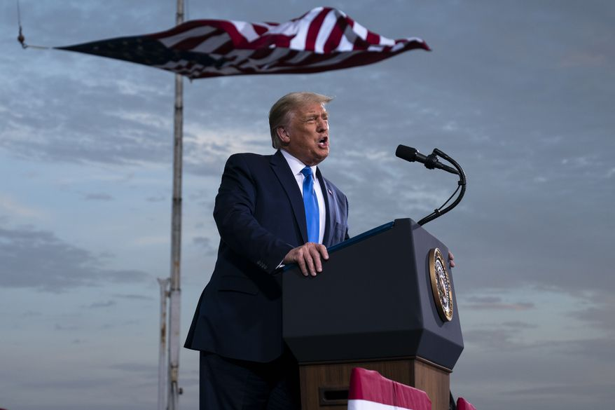 President Donald Trump speaks during a campaign rally at Cecil Airport, Thursday, Sept. 24, 2020, in Jacksonville, Fla. (AP Photo/Evan Vucci)