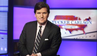 """Tucker Carlson, host of """"Tucker Carlson Tonight,"""" poses for photos in a Fox News Channel studio, in New York in this March 2, 2017, file photo.  A Manhattan judge has tossed out a defamation lawsuit against Fox News brought by the former Playboy model who took a $150,000 payoff to squelch her story of an affair with Donald Trump. Karen McDougal had alleged in the suit filed late last year that Fox host Tucker Carlson slandered her by calling the payout """"a classic case of extortion."""" The judge ruled Thursday, Sept. 24, 2020 that the remarks were """"rhetorical hyperbole."""" (AP Photo/Richard Drew, File)"""