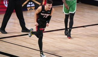 Miami Heat guard Tyler Herro (14) celebrates a basket against the Boston Celtics late in the second half of Game 4 of an NBA basketball Eastern Conference final, Wednesday, Sept. 23, 2020, in Lake Buena Vista, Fla. (AP Photo/Mark J. Terrill)