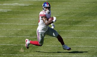 FILE - In this Sunday, Sept. 20, 2020, file photo, New York Giants tight end Evan Engram (88) runs after a catch against the Chicago Bears during the second half of an NFL football game in Chicago. The 2017 first-round draft pick had shown flashes in his first three seasons, only to be slowed by injuries, again and again. (AP Photo/Charles Rex Arbogast, File)