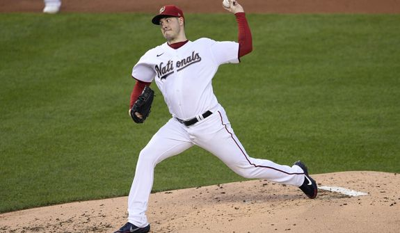Washington Nationals starting pitcher Patrick Corbin throws during the third inning of the team's baseball game against the New York Mets, Thursday, Sept. 24, 2020, in Washington. (AP Photo/Nick Wass)