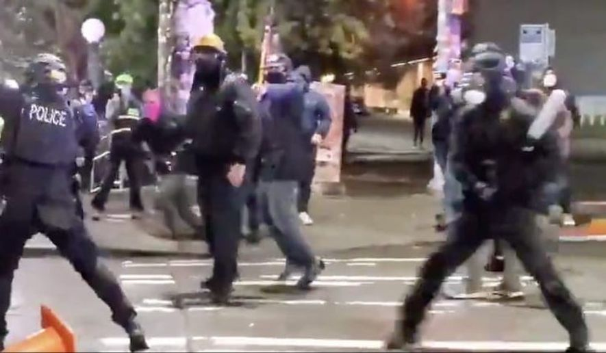 Riot police are shown in this undated file photo. (Seattle Police Department)  **FILE**