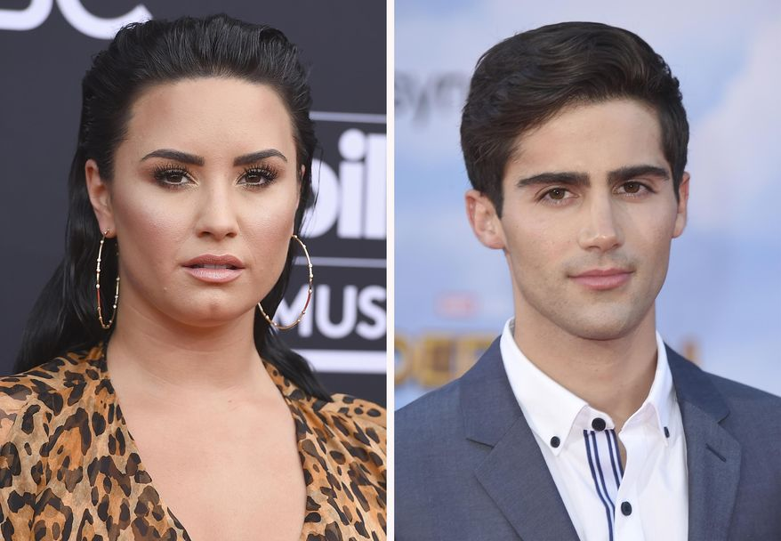 "In this combination photo, Demi Lovato, left, arrives at the Billboard Music Awards on May 20, 2018, in Las Vegas and Max Ehrich arrives at the ""Spider-Man: Homecoming"" premiere on June 28, 2017, in Los Angeles. Singers-actors Lovato and Ehrich have called off their engagement after two months, according to a person close to Lovato who spoke Thursday, Sept. 24, 2020, on condition of anonymity due to the sensitivity of the matter.  (AP Photo)"