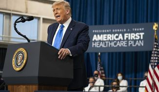 President Donald Trump delivers remarks on healthcare at Charlotte Douglas International Airport, Thursday, Sept. 24, 2020, in Charlotte, N.C. (AP Photo/Evan Vucci)