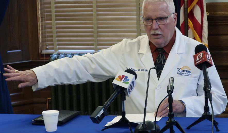 "Dr. Lee Norman, the head of the Kansas Department of Health and Environment, answers questions from reporters about the coronavirus pandemic during a news conference, Wednesday, Sept. 23, 2020, at the Statehouse in Topeka, Kan. Kansas is reporting another record seven-day spike in new coronavirus cases, and Norman says it's a sign that there's community spread in even the state's ""frontier"" counties. (AP Photo/John Hanna)"