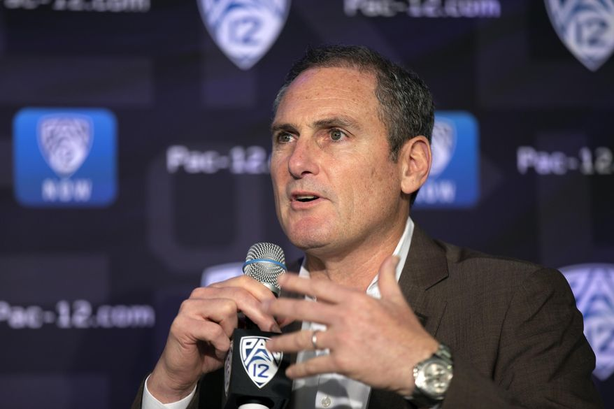 In this Oct. 7, 2019, file photo, Pac-12 Commissioner Larry Scott speaks to reporters during the Pac-12 Conference women's NCAA college basketball media day in San Francisco. The Pac-12 university presidents and chancellors will meet Friday, Sept. 17, 2020, and be presented options for staging a fall football season, but Commissioner Larry Scott says a vote by the the CEO Group is not expected. (AP Photo/D. Ross Cameron, File)  **FILE**