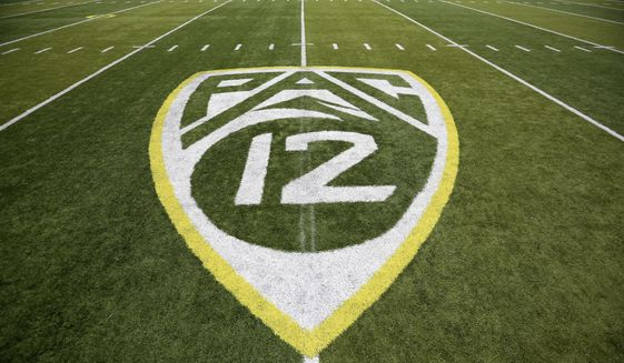 In this Oct. 10, 2015, file photo, a PAC-12 logo is displayed on the field before an NCAA college football game between Washington State and Oregon in Eugene, Ore. The Pac-12 university presidents and chancellors will meet Friday, Sept. 17, 2020, and be presented options for staging a fall football season, but Commissioner Larry Scott says a vote by the the CEO Group is not expected. (AP Photo/Ryan Kang, File)  **FILE**