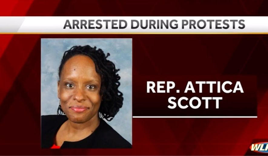 Kentucky state Rep. Attica Scott was arrested and charged with felony rioting Thursday night during a second night of violent protests sparked by the grand jury decision in the Breonna Taylor case. (Screengrab via WLKY)