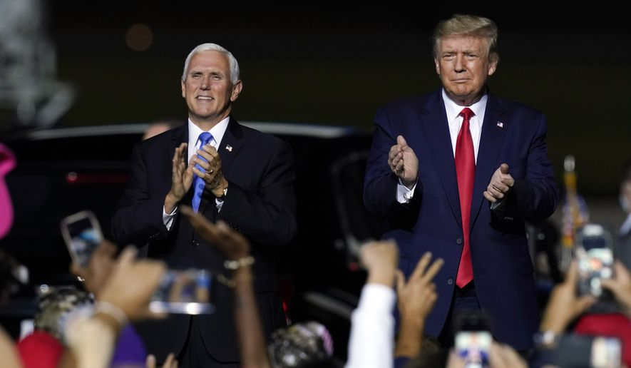 President Donald Trump and Vice President Mike Pence arrive at a campaign rally Friday, Sept. 25, 2020, in Newport News, Va. (AP Photo/Steve Helber)