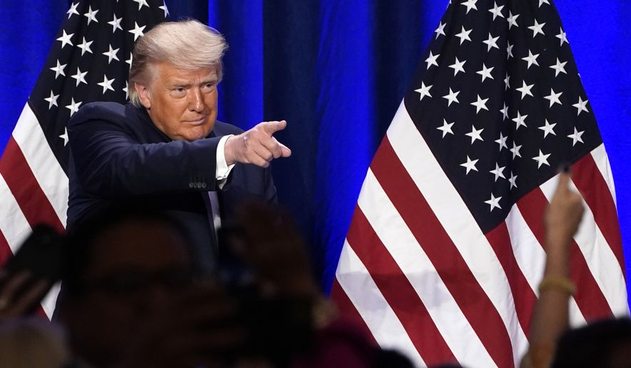 President Donald Trump gestures to supporters after a Latinos for Trump event at Trump National Doral Miami resort, Friday, Sept. 25, 2020, in Doral, Fla. (AP Photo/Evan Vucci)
