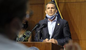 In this Sept. 1, 2020, photo, Virginia Gov. Ralph Northam listens to a reporter's question during a press briefing inside the Patrick Henry Building in Richmond, Va.  Northam and his wife have both tested positive for the coronavirus. The governor's office said in a statement Friday, Sept. 25,  that Northam no symptoms while those of Pam Northam are mild. (Bob Brown/Richmond Times-Dispatch via AP) **FILE**