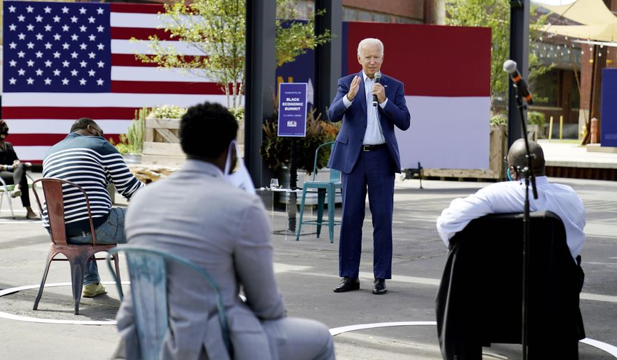In this Sept. 23, 2020, photo Democratic presidential candidate former Vice President Joe Biden speaks during a Biden for President Black economic summit at Camp North End in Charlotte, N.C. The final stretch of a presidential campaign is typically a nonstop mix of travel, caffeine and adrenaline. But as the worst pandemic in a century bears down on the United States, Joe Biden is taking a lower-key approach. (AP Photo/Carolyn Kaster) **FILE**