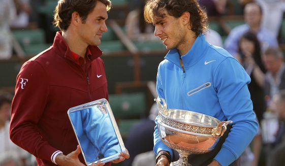 FILE  - In this June 5, 2011, file photo, Spain's Rafael Nadal, right, and Switzerland's Roger Federer pose with their trophies after the men's final match for the French Open tennis tournament at Roland Garros stadium in Paris. Nadal can pull even with Federer for most Grand Slam singles titles won by a man by collecting No. 20 at the French Open, when play begins on Sunday, Sept. 27. (AP Photo/Lionel Cironneau, File)