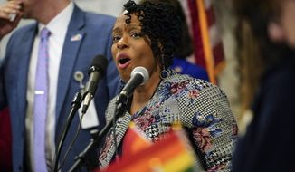 In this Wednesday, Feb. 19, 2020 file photo, Kentucky state Rep. Attica Scott speaks at a rally held by Fairness Campaign to advance LGTBQ rights, in the Rotunda at the State Capitol in Frankfort, Ky. State Rep. Attica Scott was arrested and charged Thursday evening, Sept. 24, 2020 with first-degree rioting, a felony, and two misdemeanor counts: unlawful assembly and failure to disperse.(AP Photo/Bryan Woolston, File)