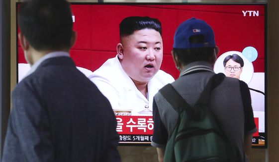 "People watch a screen showing a file image of North Korean leader Kim Jong-un during a news program at the Seoul Railway Station in Seoul, South Korea, Friday, Sept. 25, 2020. Kim apologized Friday over the killing of a South Korea official near the rivals' disputed sea boundary, saying he's ""very sorry"" about the ""unexpected"" and ""unfortunate"" incident, South Korean officials said Friday. (AP Photo/Ahn Young-joon)"