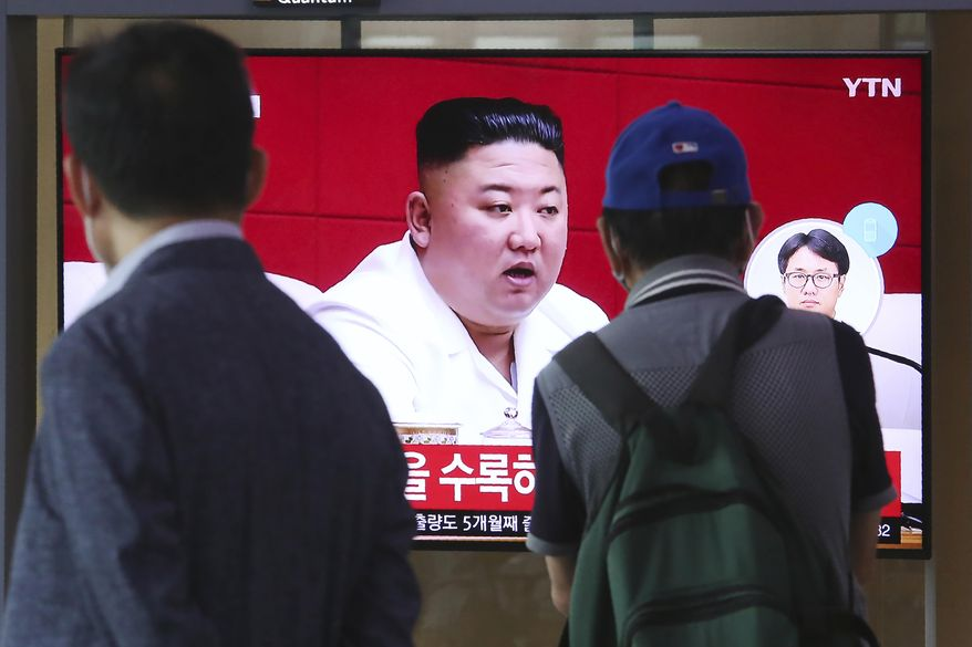 """People watch a screen showing a file image of North Korean leader Kim Jong-un during a news program at the Seoul Railway Station in Seoul, South Korea, Friday, Sept. 25, 2020. Kim apologized Friday over the killing of a South Korea official near the rivals' disputed sea boundary, saying he's """"very sorry"""" about the """"unexpected"""" and """"unfortunate"""" incident, South Korean officials said Friday. (AP Photo/Ahn Young-joon)"""