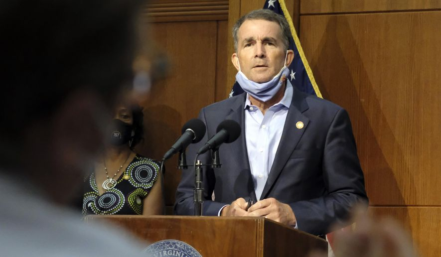In this Sept. 1, 2020, file photo, Virginia Gov. Ralph Northam listens to a reporter's question during a press briefing inside the Patrick Henry Building in Richmond, Va.  Northam and his wife have both tested positive for the coronavirus. (Bob Brown/Richmond Times-Dispatch via AP)