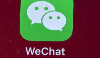 Icons for the smartphone apps WeChat are seen on a smartphone screen in Beijing, on Aug. 7, 2020.  (AP Photo/Mark Schiefelbein, File)