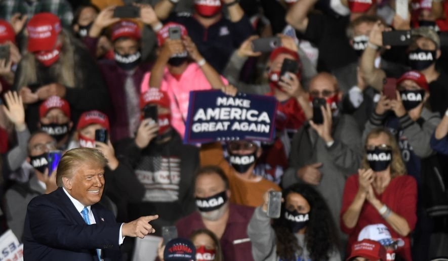 President Donald Trump smiles during a campaign rally at Harrisburg International Airport, Saturday, Sept. 26, 2020, in Middletown, Pa. (AP Photo/Steve Ruark)