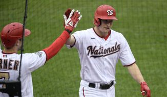 Washington Nationals' Andrew Stevenson, right, celebrates his inside-the-park home run with Trea Turner, left, during the fifth inning of the first baseball game of a doubleheader against the New York Mets, Saturday, Sept. 26, 2020, in Washington. The game is a makeup from Sept. 25. (AP Photo/Nick Wass)