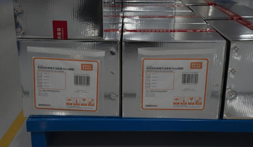 "Boxes of SARS CoV-2 Vaccine for COVID-19 stamped with the words ""State Authorized, Emergency Use"" produced by SinoVac are stacked at its factory in Beijing on Thursday, Sept. 24, 2020. Under an emergency use regulation, hundreds of thousands of people in China have been given Chinese vaccines, before final regulatory approval for general use. It's a highly unusual move that raises ethical and safety questions, as companies and governments worldwide race to develop a vaccine that will stop the spread of the new coronavirus. (AP Photo/Ng Han Guan)"