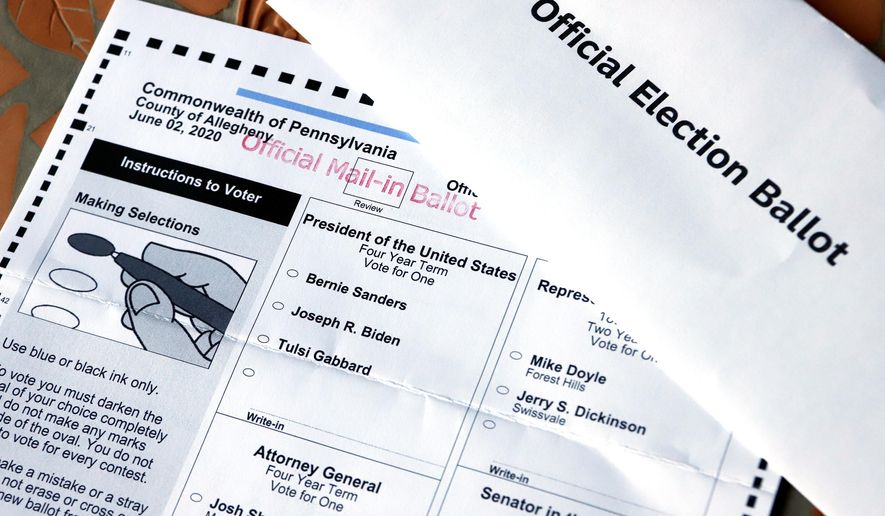 This May 26, 2020, file photo shows an Official Democratic General Primary mail-in ballot and secrecy envelope, for the Pennsylvania primary in Pittsburgh. (AP Photo/Gene J. Puskar, File)